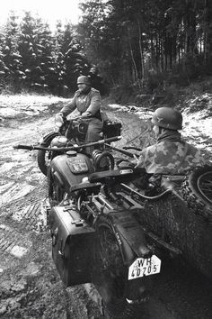 German Soldiers riding BMW motorcycles.