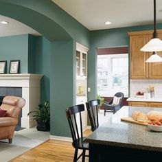 Pretty paint color ~ relaxing yet fun feeling and the open kitchen and living area is great