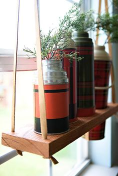 DIY hanging wooden display shelf - I have not seen this idea for a vintage thermos, and I like it!