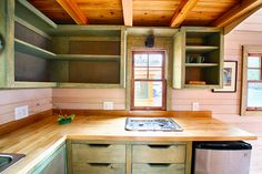DRAWERS! A tiny house on wheels in Asheville, North Carolina. Photos taken by Chris Tack at Tiny House Conference. Built by Wishbone Tiny Homes.