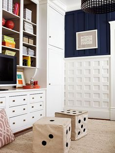 Creative remodeling is at its best when it solves several problems -- design and function -- at once. This storage-and-detail-packed family room is a good example. Several different types of storage -- drawers, doors, open shelving -- help keep family room items in good order. On walls and cabinets, different configurations of moldings add texture and variety to walls./