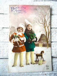 Antique winter postcard - Art deco coat hat boots, little girls child, toys doll…