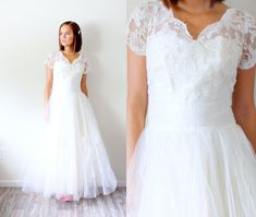 This is a beautiful ivory all lace true vintage 50s wedding dress. I love its classic silhouette with its full circle skirt and short sleeves. The