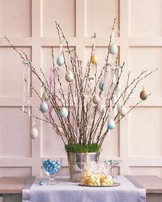 Easter Egg Tree   Martha Stewart Living - In Germany and Austria, it's customary to celebrate Easter by hanging hollow eggs from the branches of trees. This year, bring the tradition indoors by creating a unique display for blown and decorated Easter eggs.