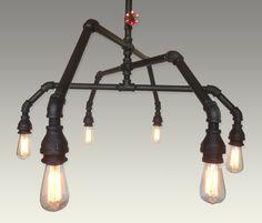 Industrial steel pipe pendant edison chandelier light. $899.00, via Etsy.