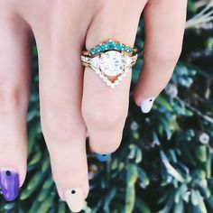 Gah!!!!  We love this classic trillion engagement ring paired with a custom paraiba nesting ring and triangle nesting ring!
