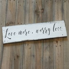 Love More sign made from reclaimed wood. Every sign is unique with possible imperfections because they are made from old wood. Each sign is made to order and may not be the exact one pictured. Each sign has been hand painted with care using specialty paints and acrylics. Each sign is distressed and r