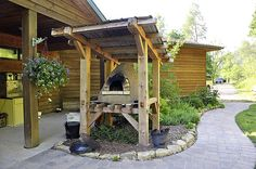 Build a handmade wood-fired mud oven, makes the best pizza! And keeps house cool in summer. this is on the to do list :)