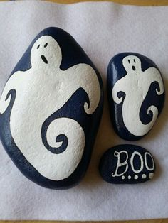 Halloween ghosts possibly accented with glow in the dark paint.