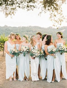 Bridesmaids in pale blue dresses with flower crowns