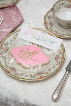 pink and green fancy plaque monogram cookie favor for baby girl's christening