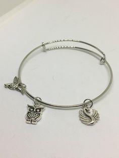 Bird charm bangle bracelet by Pinkarrowheadranch on Etsy https://www.etsy.com/listing/511324000/bird-charm-bangle-bracelet