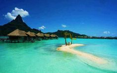 Bora Bora - I want so badly to go stay in one of the tiki huts over the water!