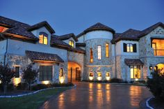 We love how this Sean Knight Custom Home looks lit up at night. www.seanknightcustomhomes.com