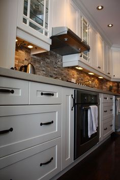 Contemporary white cabinets. Cabinet refacing done by www.granitetransformations.ca
