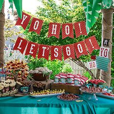 This is a colorful kid's pirate party that includes parrots, palm trees and pirate boats of all sizes. Featuring a beautiful buffet of food, pirate costumes for the kid's and is simple to recreate with a printable PDF kit.