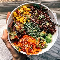 Buddha bowl with corn, roasted japanese sweet potato, shredded sesame carrots, avocado & quinoa