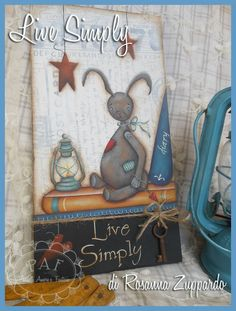 Life simple and small, old things that make the heart beat ... a lantern, an old and beloved stuffed bunny. This sweet model was designed and painted by Rosanna Zuppardo and is available in Italian and English language HERE: http://pennelliamorefantasia.blogspot.it/2016/05/live-simply.html    https://www.etsy.com/it/shop/RosannaZuppardo?ref=hdr_shop_menu