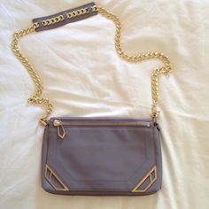 """NWT Botkier Deco Crossbody Clutch Ultra chic lavender leather crossbody purse that doubles as a clutch when chain strap is removed. Barely distinguishable marks from existing as shown in photo, but in otherwise pristine condition. Removable chain strap has 22"""" drop. 7 1/2"""" high x 12"""" wide x 1 1/2"""" deep. Botkier Bags Crossbody Bags"""