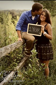 NIce shot of a couple with a small chalk board. nice idea.