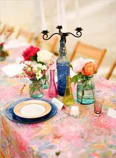 I love the idea of little multicolored bottles and mason jars as #DIY centerpieces