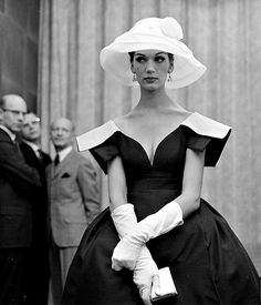 Simone D'Aillencourt in low cut dress with square organdy collar by Galanos, photo by Nina Leen, 1959