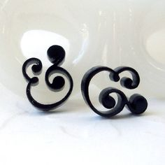 Little bitty black ampersands. Laser cut acrylic, stainless steel posts. Isette's shop on etsy $10
