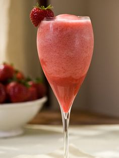 Taste of the Tropics Cocktail - 2 oz. Bacardi light rum, 2 oz. Coco Lopez, 6 oz. pineapple juice, 1 1/2 cups crushed strawberries or purée, 1 whole strawberry, 1 1/2 cups ice .... sounds like it could be my new favorite!