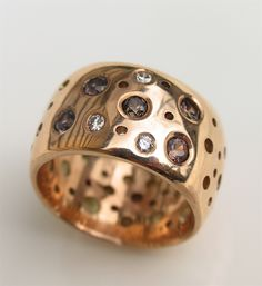 rose gold diamond colour change sapphires  wedding ring. I can't believe it, but I love this.