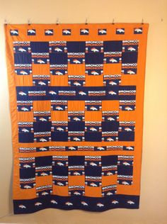 Go Bronco's homemade extra large lap quilt-throw.  Size 75' by 55' by emeraldfirequilts on Etsy