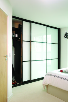 Bedroom closet doors. Kensington range sliding wardrobe door with Japanese style panels and white glass from IDS.