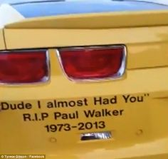 Sweet tribute:  A fan surprised Tyrese by arriving to see him in a yellow sports car with 'Dude I almost had you,' a quote from Paul's character Brian O'Connor written on it along with 'R.I.P Paul Walker 1973 - 2013'