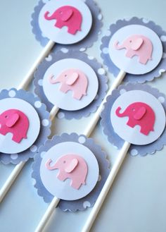 Elephant Cupcake Toppers but make a little larger and put in centerpieces (tall glass vases filled with peanuts)