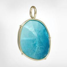 Turquoise stone from the Harriet Collection wrapped in 14k yellow gold wire