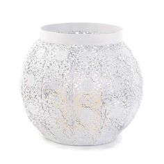 White Lace Design Candleholder from Koehlerhomedecor.com  This rounded candle holder features an intricate design that casts fascinating patterns of candlelight and shadow. Add a candle of your choice inside and bask in the sophisticated glow!  Buy wholesale at Koehler Home Décor.