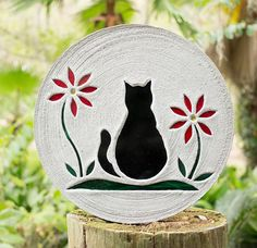 A black cat cat overlooks a garden of red flowers, perfect for a garden centerpiece or pet memorial. I can make this cat and the flowers in other colors to match your favorite kitty, just contact me and let me know. You will love my stepping stones because; ~ They are big and tough enough to walk on and will put a smile on your face for many years to come. ~ The original designs are hand cut from stained glass and embedded in high strength concrete featuring a textured, non slip surface…