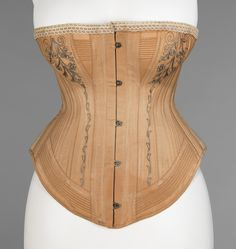 "Corset: ca. 1885-1887, American, cotton, silk, metal, bone, elastic; embroidered. Marking: Stamped: ""Pat'd July 7, 1885"""