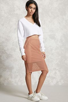 c601e10127c A knit skirt featuring a netted-mesh overlay