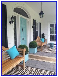 front door colors The black-white-and-wood porch might make most select a black or wood door. The aqua blue front door gives personality about the creamy white siding and black accents. Exterior Paint Colors For House, House Shutters, House With Porch, Paint Colors For Home, Painted Front Doors, Victorian Front Doors, Windows Exterior, House Exterior, Porch Design