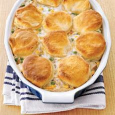 Easy Chicken and Dumplings 4 lbs chicken meat (rotisserie, shredded) 10 ozs frozen mix veget 103/4 ozs condensed cream of mushroom soup 1/4 tsp kosher salt 1/4 tsp black pepper 1 refrigerated biscuits (10-count tube) Combine the chicken, vegetables, soup, salt, pepper, and 3/4 cup water in a large bowl. Transfer the mixture to an oven-safe casserole dish, cover with foil, bake for 30 minutes. After 15 minutes, place the biscuits on top, about 15 minutes.
