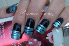 Black and blue nail art with stripes by TinyCarmen