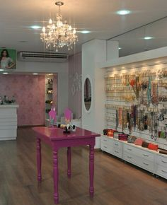 The pink display table is a nice accent piece. The chandelier is stunning