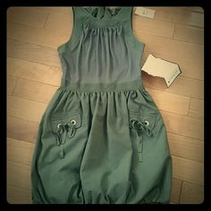 "NWT Miss Sixty Tank Bubble Dress sz 6 New w tag. Super trendy Olive Green Miss Sixty dress. Tank on top, bubble dress bottom. Satin tie back.   * 13.5"" waist layed flat  * dress length 33.5"" * 15"" armpit to armpit  * side zipper closure  * front pocket details * top part 62% polyester,  33 % rayon, 5 % spandex  * bottom part 65% polyester,  35% cotton Miss Sixty Dresses Midi"