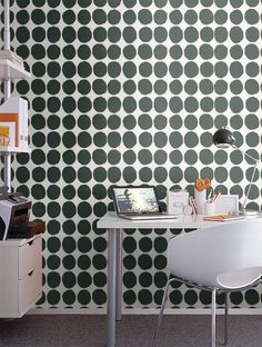 I wish!  Maybe there is a way to create the look of marimekko wallpaper . . . ?