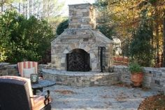 Outdoor fireplace with hearth bench