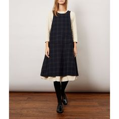 Our charming blackwatch tartan Pini Apron Dress looks beautiful layered over almost anything especially long dresses. Also available in a gorgeous Oatmeal.