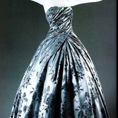 This iconic Compiègne ball gown from Dior's 1954 Collection. Sublime...and worth repeating. Kudos Galliano and House of Dior Haute Couture Atelier!