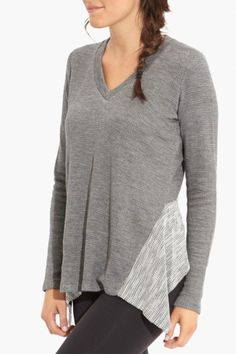 """Our new go-to cold weather piece, A Moment Pullover is made with a super-soft slub yarn that will """"have you at hello."""" Low V-neck front. Reverse fabric contrast hemline.High-low hem. Moment Pullover by Beyond Yoga. Clothing - Tops - Long Sleeve Naples, Florida"""