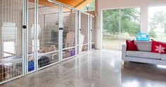 A built-in kennel is perfect for devoted pet owners and those who like to foster shelter pets. Search Donald Gardner home plans here http://www.dongardner.com/. #PetFriendly #HillsideWalkout #HomeDesign