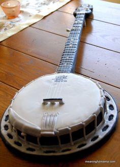 It's a banjo cake!  If Luke doesn't get a banjo cake for his groom's cake, then I will promise to make him one one day. I think it's too precious.